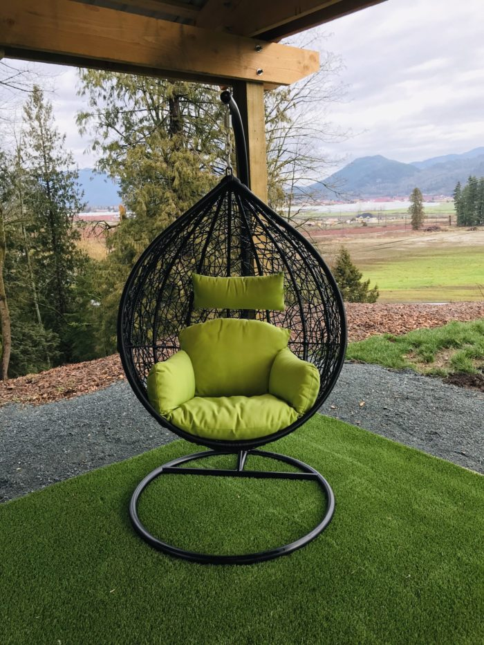 Teardrop swing with green cushion