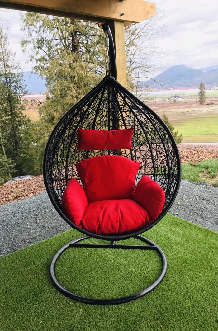 Teardrop swing with red cushion