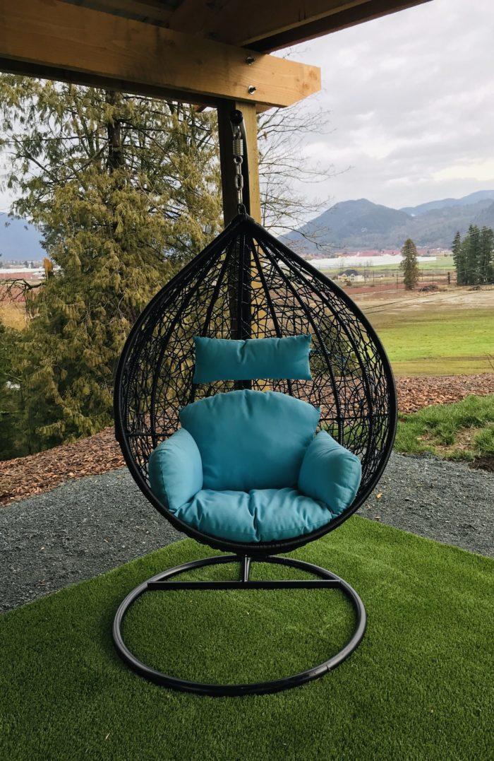 Teardrop swing with blue cushion