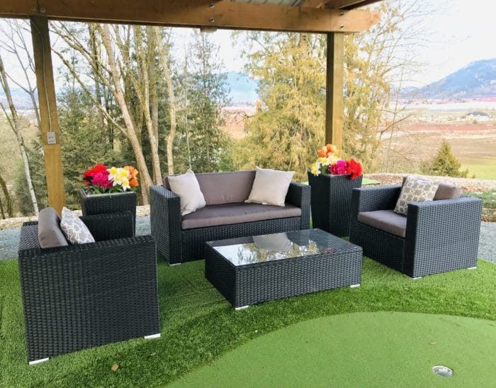 4 piece conversation set with glass table and dark grey cushions