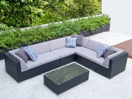 Giant L with glass table and light grey cushions