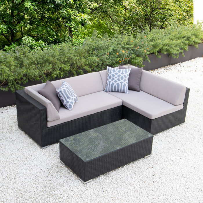 Small L with glass table and light grey cushions
