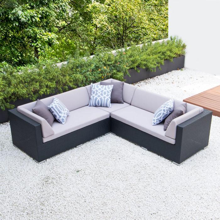 Symmetrical L with light grey cushions