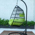 Single folding swing with green cushion