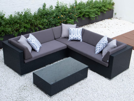 Symmetrical L with glass table in dark grey cushions