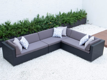 Giant L sectional in dark grey cushions