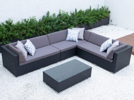 Giant L with glass table in dark grey cushions