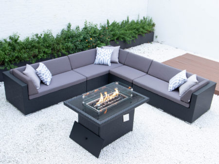Giant symmetrical L with wicker fire table in dark grey cushions