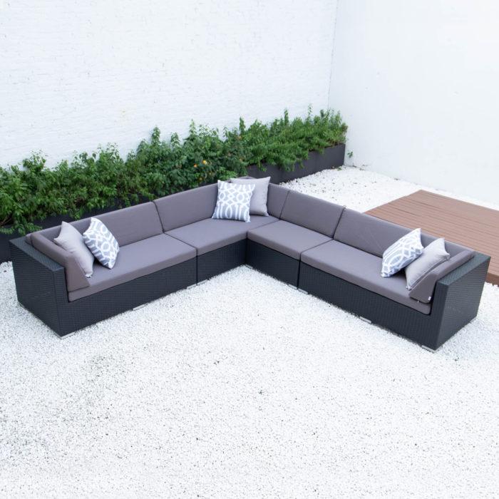 Giant symmetrical L sectional in dark grey cushions