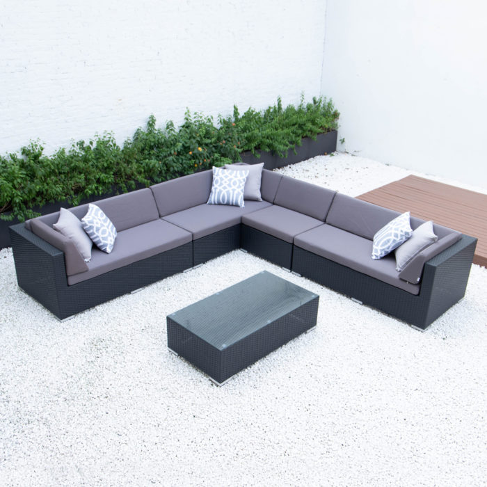 Giant symmetrical L with glass table in dark grey cushions