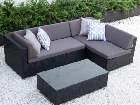 Small L with glass table in dark grey cushions