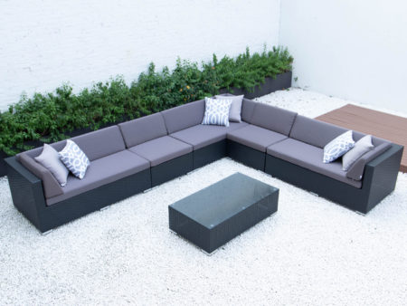 Super Giant L with glass table in dark grey cushions