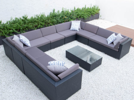 Giant u shaped with glass table in dark grey cushions
