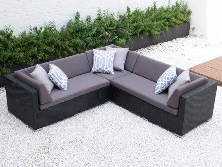 Symmetrical L sectional with dark grey cushions