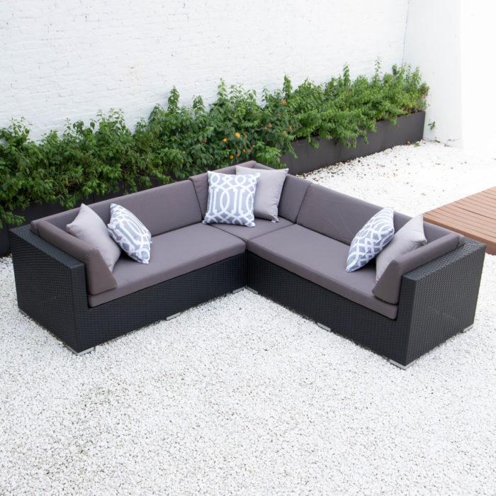 Symmetrical L sectional with dark grey cushions