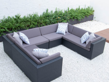 U shaped sectional with dark grey cushions
