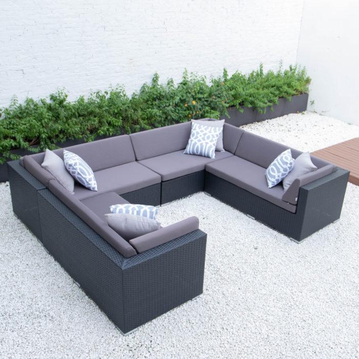 U shaped sectional with dark grey cushions
