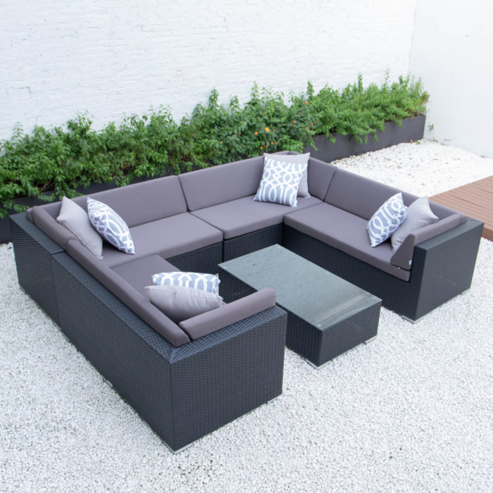 U shaped with glass table in dark grey cushions